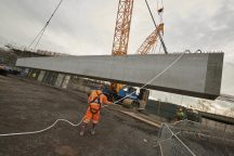 First giant concrete bridge beam lifted into place
