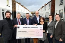 ISG Builds on Walking With the Wounded Support with Charity Cheque