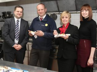 Compton Hospice corporate fundraiser Simon Cater and PR & marketing officer Grace Ruston show Redrow's Dave Dodd & Jenny Atkinson around the hospice kitchen