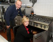 Redrow's Dave Dodd & Jenny Atkinson test out the new kitchen equipment at Compton Hospice.