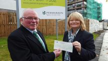 Lead Trustee Bill Smith presented with £1,000 by Persimmon Homes Sales Advisor Roseann Boyle