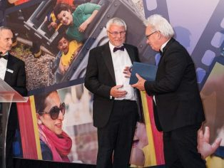 KidsOut chair David Kelland (left) presenting the award to Designer Contracts.