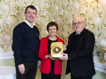 Andy Makin, Managing Director of EnviroVent presenting the gold coloured filterless fan to Cllr Judy Hamilton and Keith Brown from Fife Council.