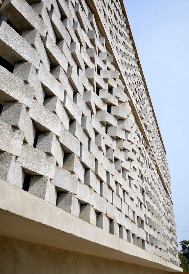 Rotating concrete block facade by SUBdv is a product of empathic