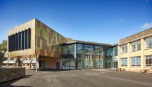 Proteus HR cladding in TECU Brass and TECU Bronze materials have created a striking, expressive façade at Bristol Grammar School's new 1532 Performing Arts Centre.