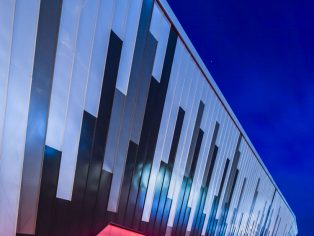 Brett Martin Daylight Systems' Marlon Clickfix1040 polycarbonate glazing panels in range of geometric shapes have played a significant role in the design of the Ice Arena Wales, bringing light and exceptional aesthetics to this stunning new world-class facility near Cardiff bay.